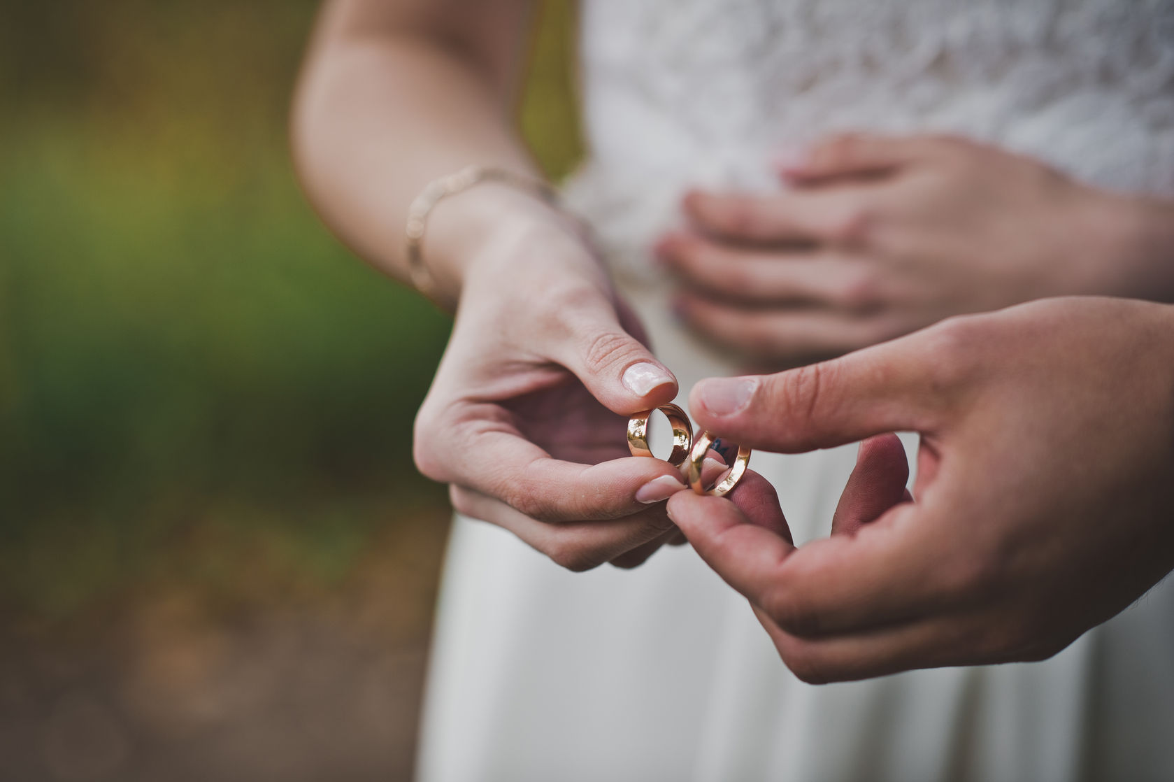 38261289 - palms of the newly-married couple with wedding rings.