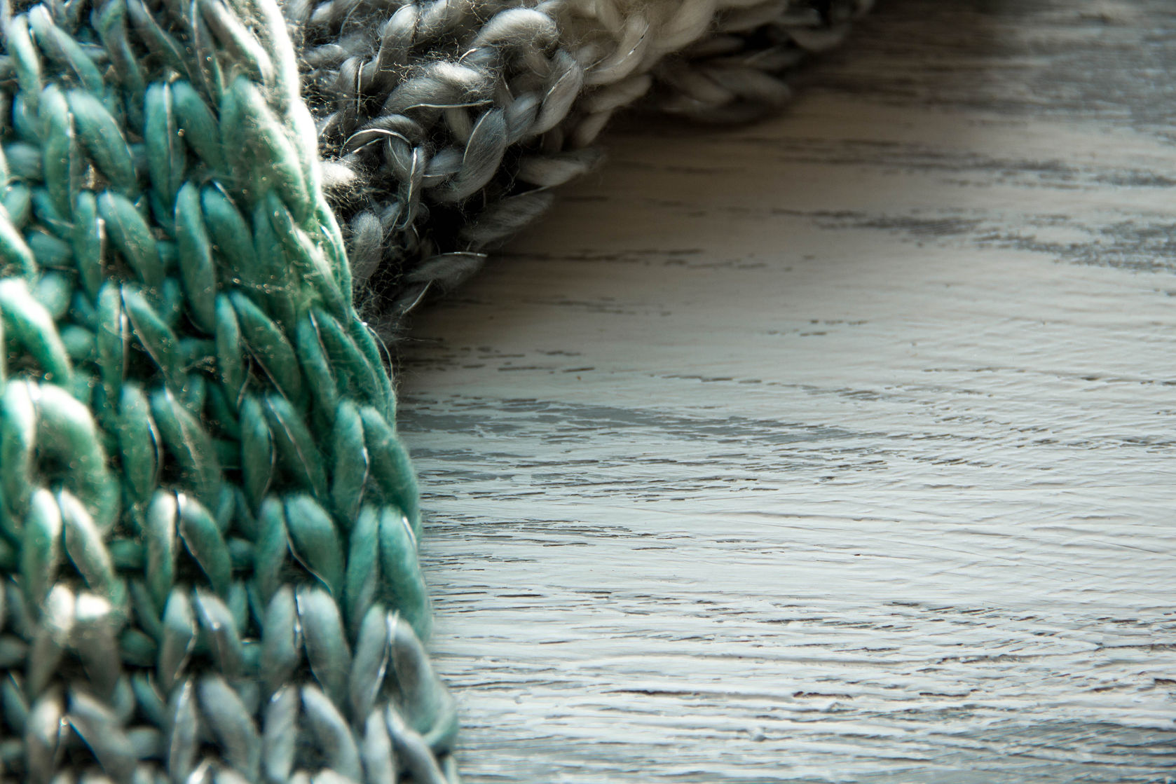 51313832 - knitted scarf texture on wooden table background